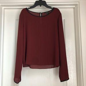 Maroon blouse.